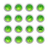 Sixteen green buttons. Symbols drawn on the surface of green glowing buttons Royalty Free Stock Image
