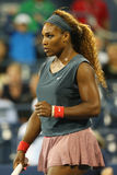 Sixteen times Grand Slam champion Serena Williams during first round doubles match with teammate Venus Williams at US Open 2013. NEW YORK - AUGUST 29 Sixteen Stock Image