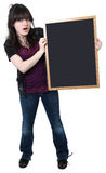 Sixteen Year Old Girl with Blank Chalkboard. Beautiful sixteen year old highschool student with blank chalkboard royalty free stock images