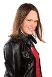 Sixteen year old teenage girl. Pretty portrait of a sixteen year old teenage girl with white background wearing a leather jacket and a smile royalty free stock image