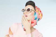 Sixties Fashion. Classy chic sixties style fashion retro woman. Sunglasses and silk scarf Stock Image
