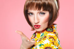 Sixties Fashion. Sixties retro style girl blowing a kiss Stock Image