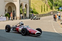 Sixties Formula 2 car at Bergamo Historic Grand Prix 2017. A Sixties Formula 2 car driving down the hairpin at the end of Boccola street in Citta` Alta the Stock Photo