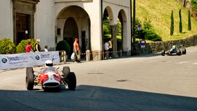Formula 2 car at Bergamo Historic Grand Prix 2017. A sixties Formula 2 car taking the hairpin at the end of Boccola street in Citta` Alta the medieval part of Royalty Free Stock Image