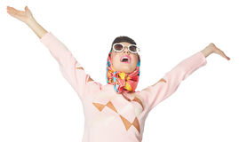 Sixties Style Girl. Retro sixties style happy girl with spread arms over white background Royalty Free Stock Images