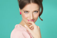 Sixties Style Girl. Sweet sixties style girl closeup over cyan background. Retro makeup Stock Photos