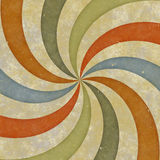Sixties style grungy sunburst swirl Stock Photos