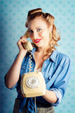 Sixties Woman Holding Vintage Telephone Handset Stock Photo