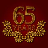 Sixty five years anniversary celebration patterned logotype. Sixty fifth anniversary vintage golden logo. With shadow Stock Image