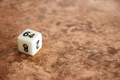 Sixty-four sided dice on Tile Stock Photo