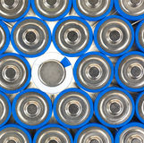 Size AA batteries with positive and one negative. A close view of several AA size batteries with one negative side up and the remainder positive side up Royalty Free Stock Images