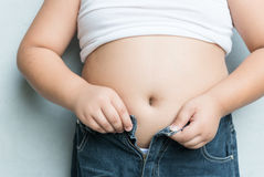 The size of belly of fat boy with overweight. Royalty Free Stock Photography