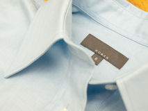 A size and brand tag on a finest-quality shirt Royalty Free Stock Images