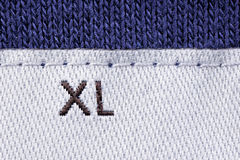 Size clothes XL. Detail marking on the label clothing size XL Stock Photos