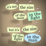 Size of the Fight in the Man Saying Bulletin Board. A saying on a bulletin board - It's not the size of the man in the fight but it's the size of the fight in Stock Images