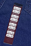 Size Info Sticker on Blue Jeans stock photography