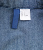 Size label on jeans shirt and white tag. Royalty Free Stock Photos