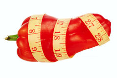 A size matters!. Measuring tape and sweet pepper on a white background Royalty Free Stock Photos