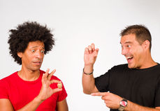 Size matters. Guys making fun of each other because of measurements Royalty Free Stock Photos