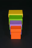 Size order. Four colorful boxes Royalty Free Stock Photography