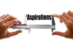 The size of our aspirations. Close up shot of a caliper measuring the word Aspirations stock photography