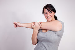 Size plus woman stretching Royalty Free Stock Photography