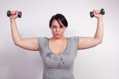 Size plus woman sweating Royalty Free Stock Image
