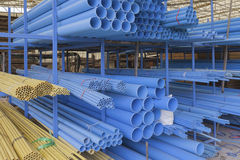Size of pvc pipes in Materials Warehouse. Stock Images