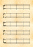 A4 size yellow sheet of old paper with music note stave with treble and bass clef Stock Photography