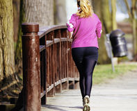 Sized woman jogging in park Royalty Free Stock Image