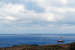 La vieille lighthouse and Sein island in Finistere coast Stock Image