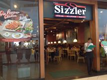 Sizzler shop. The image of the Sizzler shop in Thailand. Sizzler is a United States-based restaurant chain with headquarters in Mission Viejo, California. It is stock images