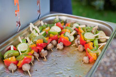 Sizzling barbecue sticks healthy vegetables Stock Photo