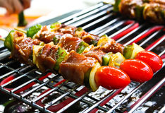 Sizzling barbecue sticks with meat Stock Photos