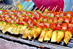 Sizzling barbecue sticks Stock Image