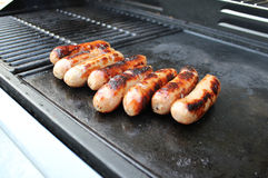 Sizzling BBQ sausages Stock Photography