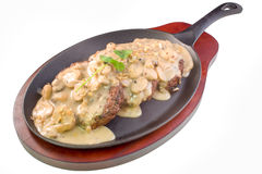 Sizzling burger steak with gravy Stock Photo