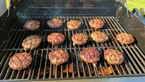 Sizzling burgers in the sun royalty free stock photo