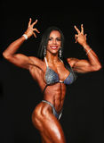 Sizzling Hot Woman Bodybuilder. Sizzling, sexy, Idaliz Alvarez displays a curvaceous and muscular body as she competes in the Women's Physique competition stock photo