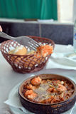 Sizzling prawns with garlic. Traditional Spanish tapas dish. Stock Image