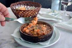 Sizzling prawns with garlic. Traditional Spanish tapas dish. Royalty Free Stock Photos