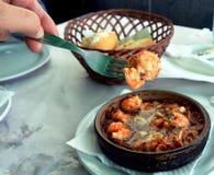 Sizzling prawns with garlic. Traditional Spanish tapas dish. Royalty Free Stock Image