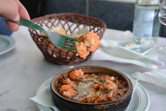 Sizzling prawns with garlic. Traditional Spanish tapas dish. Royalty Free Stock Images
