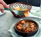 Sizzling prawns with garlic. Traditional Spanish tapas dish. Royalty Free Stock Photo