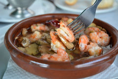 Sizzling prawns with mushroom and garlic. Stock Images