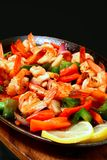 Sizzling shrimp. Delicious spicy prawns served on a hot iron plate stock photography