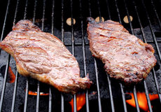 Sizzling Steaks On The Grill Royalty Free Stock Image