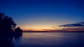 Sjö efter tidschackningsperiod för solnedgång 4K stock video