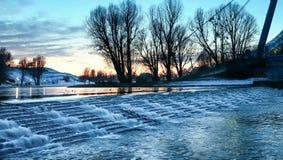Sjö i vintersolnedgång royaltyfria bilder