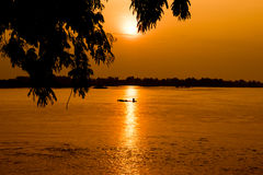 Sjö-solnedgång-flod-mekong-Asien-Laos Arkivbilder